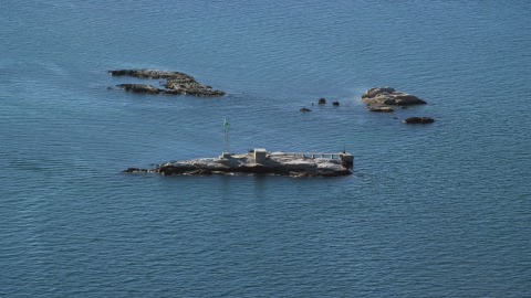 AX144_183.0000000 - Aerial stock photo of A view of Dumpling Rocks Light on Dumpling Rocks, Massachusetts