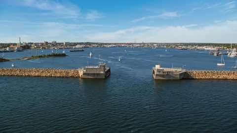AX144_191.0000011 - Aerial stock photo of Palmer Island Light and the harbor in New Bedford, Massachusetts