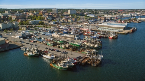 AX144_194.0000003 - Aerial stock photo of Fishing boats docked at piers in New Bedford, Massachusetts