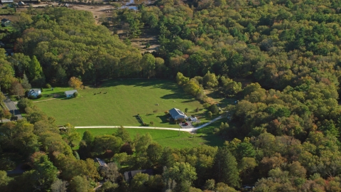 AX144_214.0000062 - Aerial stock photo of Rural homes and green lawns surrounded by trees, Dartmouth, Massachusetts