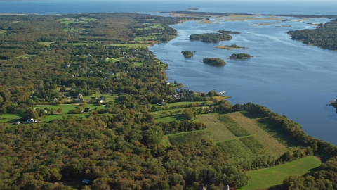 AX144_216.0000000 - Aerial stock photo of A rural coastal neighborhood, tiny islands in bay, Westport, Massachusetts