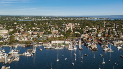 AX144_232.0000172 - Aerial stock photo of Boats docked at piers in the busy harbor in Newport, Rhode Island