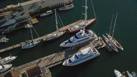 AX144_238.0000119 - Aerial stock photo of Two yachts docked near sailboats at piers in Newport, Rhode Island