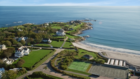 AX144_248.0000229 - Aerial stock photo of Oceanfront mansions in the coastal city of Newport, Rhode Island