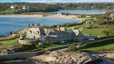 AX144_251.0000189 - Aerial stock photo of A beautiful oceanfront mansion in Newport, Rhode Island
