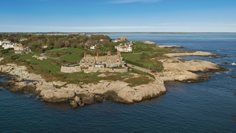 AX144_252.0000017 - Aerial stock photo of An oceanfront mansion beside coastal cliffs, Newport, Rhode Island