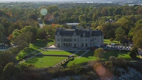 AX144_258.0000091 - Aerial stock photo of Ochre Court, an oceanfront mansion in Newport, Rhode Island