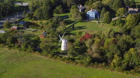 AX145_003.0000029 - Aerial stock photo of A small windmill in Portsmouth, Rhode Island