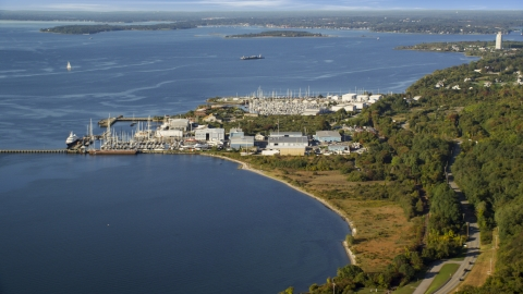 AX145_005.0000000 - Aerial stock photo of Marinas and warehouses on the coast in Portsmouth, Rhode Island