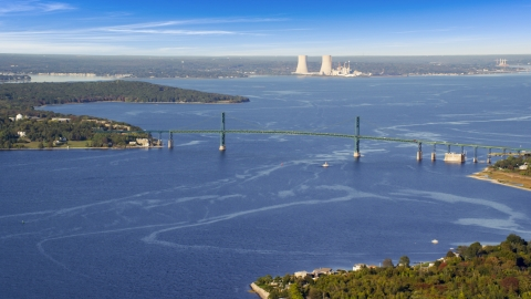 AX145_009.0000059 - Aerial stock photo of Mount Hope Bridge and the Dynegy Brayton Point, Portsmouth, Rhode Island