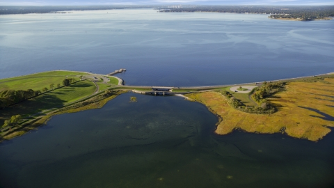 AX145_014.0000067 - Aerial stock photo of A small bridge beside a bay in Bristol, Rhode Island