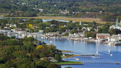 AX145_016.0000312 - Aerial stock photo of A small coastal town, waterfront properties, and sailboats, Warren, Rhode Island