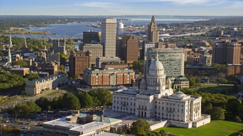 AX145_056.0000262 - Aerial stock photo of The Rhode Island State House, and Downtown Providence skyscrapers in background, Rhode Island