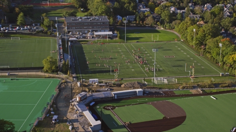 AX145_064.0000179 - Aerial stock photo of Football practice on a field at Brown University, Providence, Rhode Island