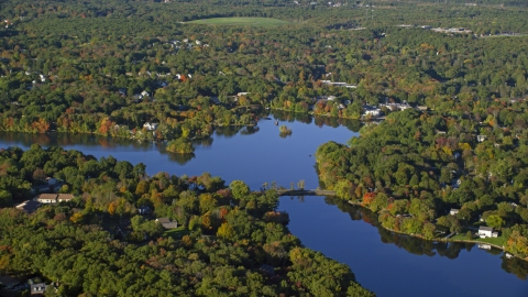 AX145_101.0000066 - Aerial stock photo of Lake Hiawatha in autumn, North Attleborough, Massachusetts