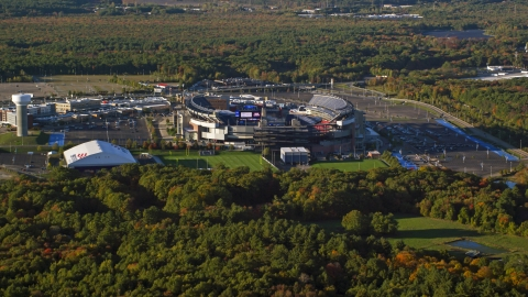 AX145_111.0000166 - Aerial stock photo of Gillette Stadium and trees in autumn, Foxborough, Massachusetts