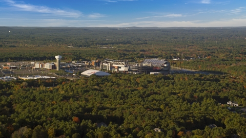 AX145_112.0000158 - Aerial stock photo of A wide view of Gillette Stadium surrounded by autumn trees, Foxborough, Massachusetts