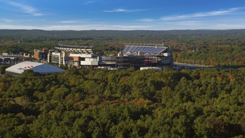 AX145_115.0000225 - Aerial stock photo of The side of Gillette Stadium in autumn, Foxborough, Massachusetts