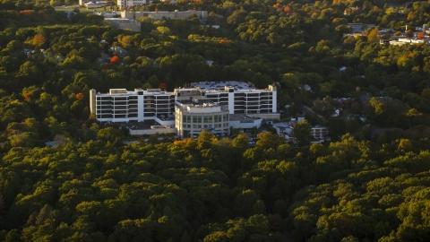 AX146_010.0000032F - Aerial stock photo of Faulkner Hospital in autumn, Jamaica Plain, Massachusetts, sunset