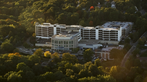 AX146_011.0000001F - Aerial stock photo of The Faulkner Hospital at sunset, in autumn, Jamaica Plain, Massachusetts