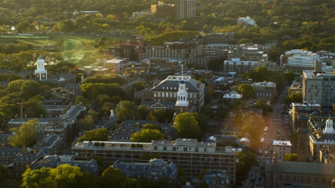 AX146_026.0000281F - Aerial stock photo of A view of Harvard University buildings at sunset in Cambridge, Massachusetts