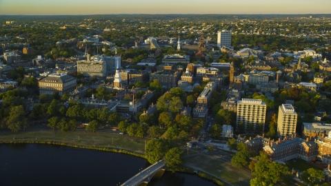 AX146_028.0000327F - Aerial stock photo of The Harvard University campus in Cambridge, Massachusetts, sunset