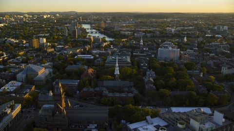 AX146_035.0000316F - Aerial stock photo of The Harvard University campus at sunset, Cambridge, Massachusetts