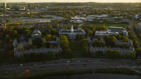 AX146_038.0000319F - Aerial stock photo of The Harvard Business School at Harvard University, Massachusetts, sunset