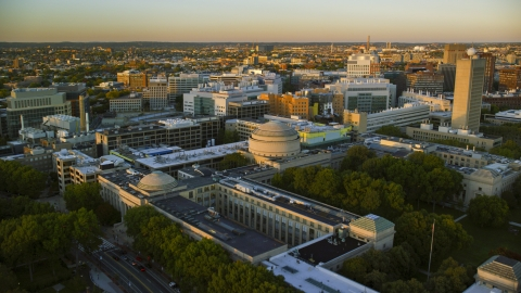 AX146_052.0000236F - Aerial stock photo of The Maclaurin Building at the Massachusetts Institute of Technology, Massachusetts, sunset