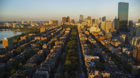 AX146_062.0000288F - Aerial stock photo of Back Bay brownstones and Downtown Boston skyscrapers, Massachusetts, sunset