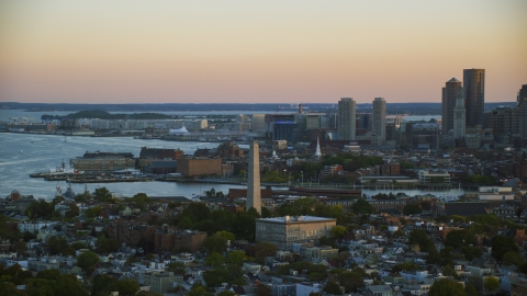 AX146_092.0000340F - Aerial stock photo of The Bunker Hill Monument at sunset in Charlestown, Massachusetts