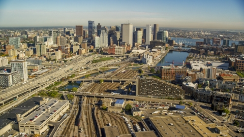 AX147_006.0000164 - Aerial stock photo of Industrial area near Downtown Boston skyscrapers, Fort Point Channel, Massachusetts