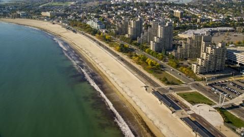AX147_014.0000346 - Aerial stock photo of Condominium complexes beside a sandy beach, Revere, Massachusetts