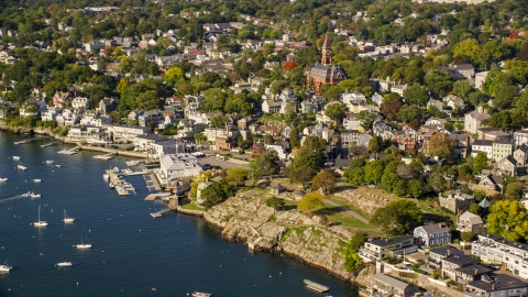 AX147_026.0000015 - Aerial stock photo of Coastal community and harbor in Marblehead, Massachusetts