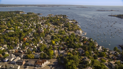AX147_030.0000181 - Aerial stock photo of Abbott Hall and coastal community along harbor, Marblehead, Massachusetts