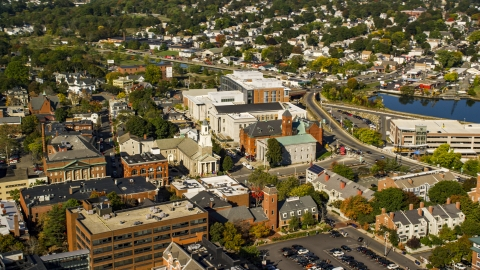 AX147_042.0000151 - Aerial stock photo of The Tabernacle Church and local businesses in autumn, Salem, Massachusetts