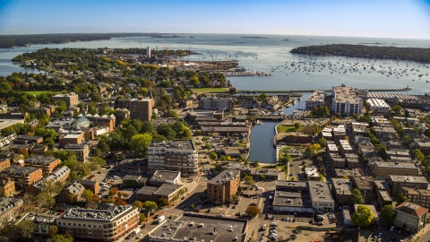 AX147_048.0000387 - Aerial stock photo of A coastal town beside a harbor, Salem, Massachusetts