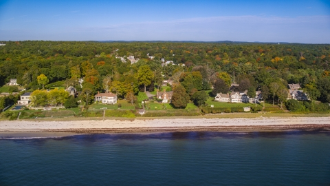 AX147_058.0000143 - Aerial stock photo of Beachfront mansions and fall foliage, autumn, Beverly, Massachusetts