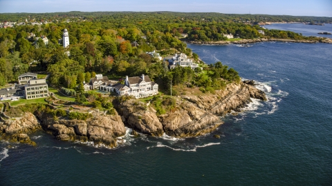 AX147_063.0000000 - Aerial stock photo of Oceanfront mansions and trees with fall foliage, Manchester-by-the-Sea, Massachusetts