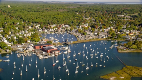 AX147_067.0000356 - Aerial stock photo of A small town harbor with boats in autumn, Manchester-by-the-Sea, Massachusetts