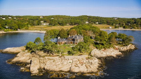 AX147_077.0000061 - Aerial stock photo of An isolated, oceanfront mansion, Manchester-by-the-Sea, Massachusetts