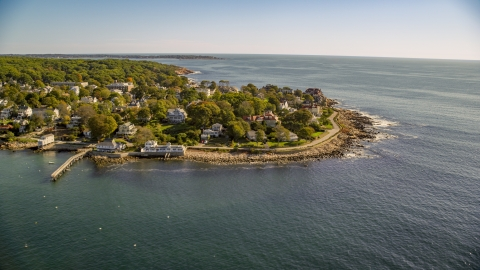 AX147_079.0000157 - Aerial stock photo of Oceanfront homes on a rocky coast in Gloucester, Massachusetts