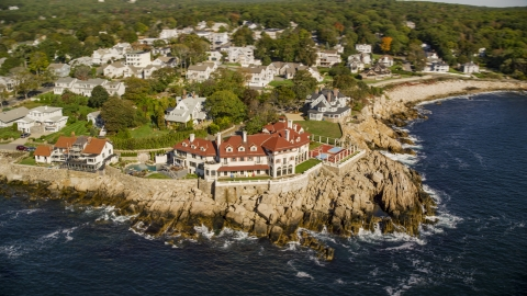 AX147_080.0000237 - Aerial stock photo of Oceanfront homes and a mansion in Gloucester, Massachusetts