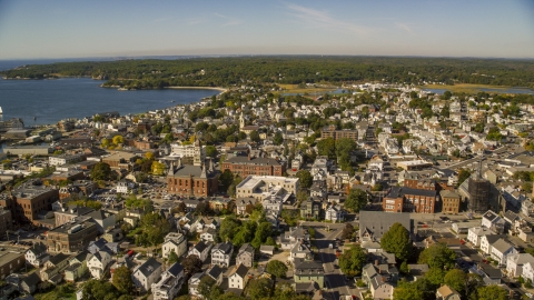 AX147_103.0000044 - Aerial stock photo of City hall in a coastal town, Gloucester, Massachusetts