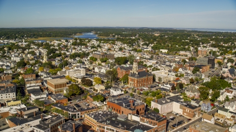 AX147_104.0000079 - Aerial stock photo of City hall in the middle of the town of Gloucester, Massachusetts