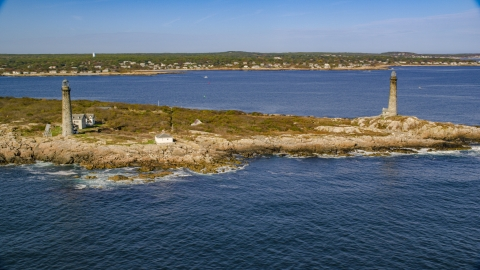 AX147_111.0000270 - Aerial stock photo of Two lighthouses on Thatcher Island, Massachusetts