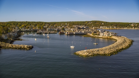 AX147_118.0000186 - Aerial stock photo of A small harbor and a coastal town, Rockport, Massachusetts