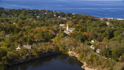 AX147_132.0000052 - Aerial stock photo of A church in a small coastal town in autumn, Gloucester, Massachusetts