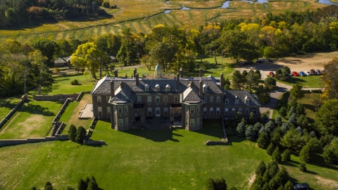 AX147_140.0000290 - Aerial stock photo of The Great House at Crane Estate on Castle Hill, autumn, Ipswich, Massachusetts