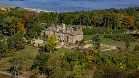 AX147_141.0000156 - Aerial stock photo of The Great House at Crane Estate and Castle Hill surrounding by trees in autumn, Ipswich, Massachusetts